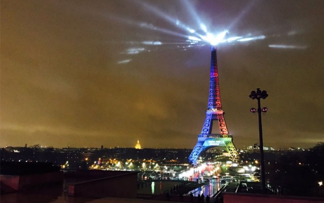 """The Eiffell Tower is lit up like the Paris 2024 Olympic bid logo with the slogan """"Made To Share"""" on Feb. 3, 0217 (Paris 2024 Photo)"""
