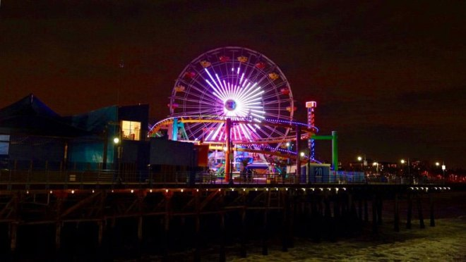 The LA 2024 angel logo lights up the night, shining from the world's only solar-powered ferris wheel in Santa Monica (LA 2024 Photo)
