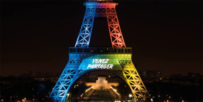 "Paris 2024 strapline ""Made for Sharing"" projected on Eiffel Tower in French (Paris 2024 Photo)"
