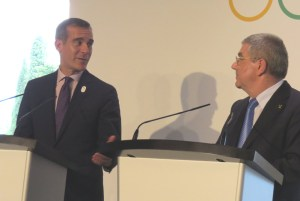 LA Mayor Eric Garcetti (left) addresses media with IOC President Thomas Bach at Olympic Museum in Lausanne (GamesBids Photo)
