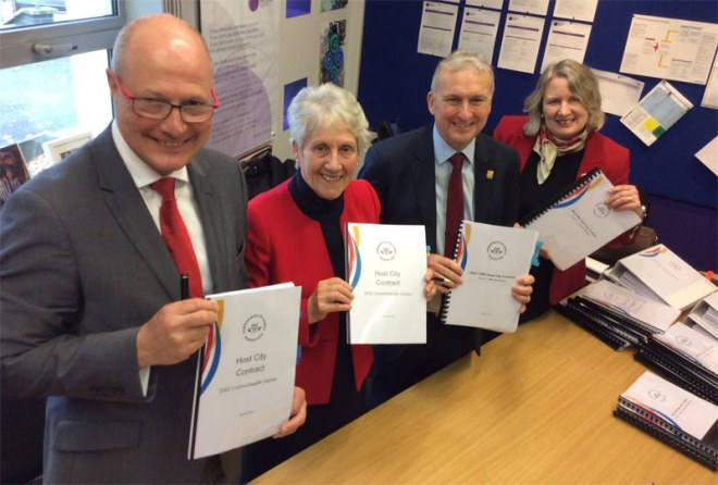 Officials, including Birmingham Mayor Andy Street, hold signed copies of the 2022 Commonwealth Games Host City Contract (Birmingham 2022 Photo)