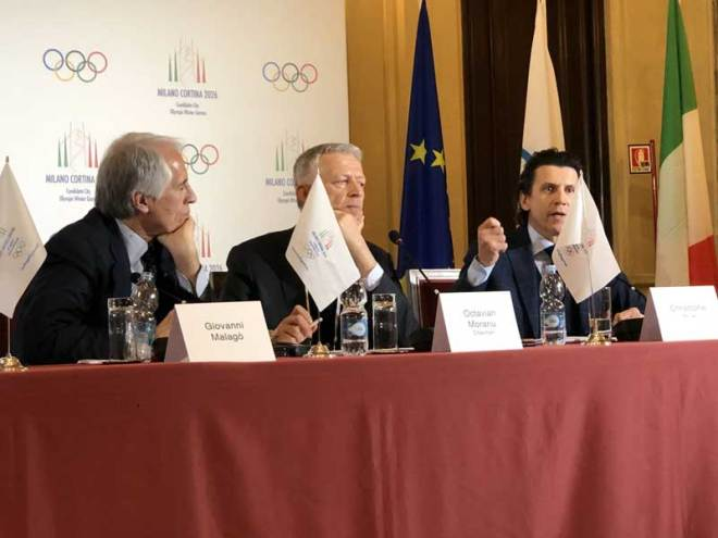 Milan-Cortina 2026 Bid Chief Giovanni Malago (left) watch IOC Evaluation Commission Chief Octavian Morariu and IOC Executive Director Christophe Dubi during a press conference at Palazzo Marino in Milan April 6, 2019 (GamesBids Photo)