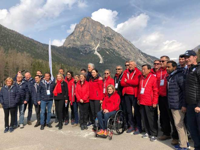 IOC Evaluation Commission team and Milano-Cortina 2026 bid team pose after viewing proposed site for temporary Cortina Olympic Village (GamesBids Photo)
