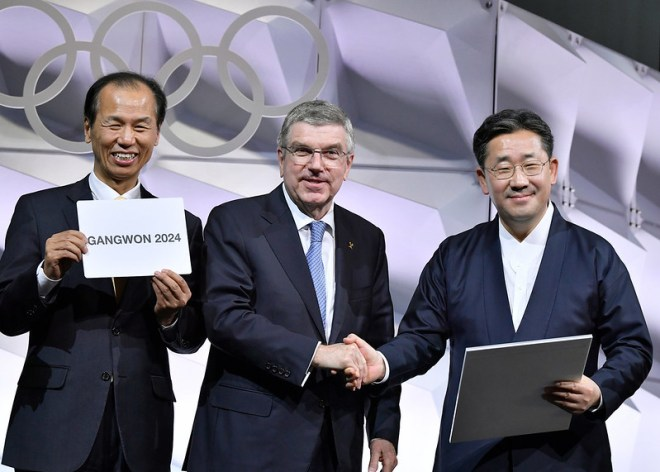 IOC President Thomas Bach (centre) with Gangwon Governor Choi Moon-soon (left) shortly after Gangwon 2024 awarded Winter Youth Olympics by 79-2 vote (Photo: Christophe Moratal/IOC)