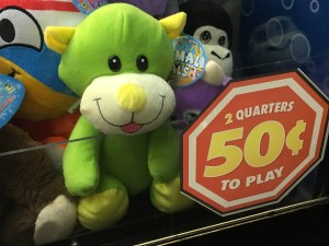 stuffed animals inside of a claw machine