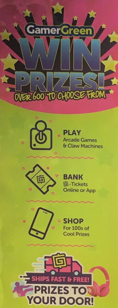 Sign on front of claw machine explaining what is GamerGreen