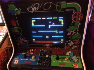 image of mario bros arcade game screen and control sticks