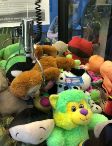 trying to win a sloth at the walmart arcade