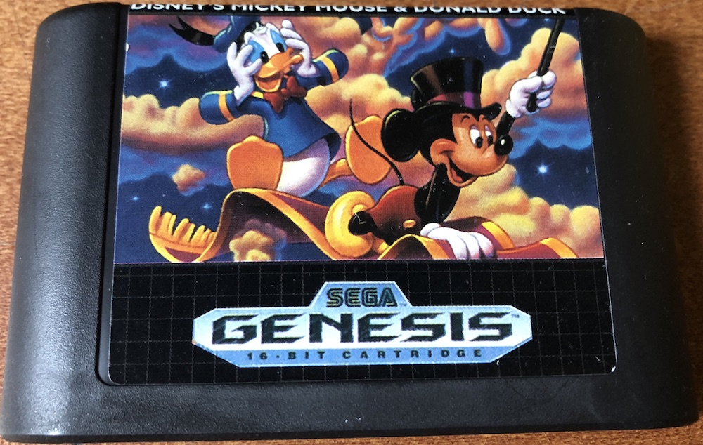 Image of world of illusion sega genesis cartridge from February retro wreck room review