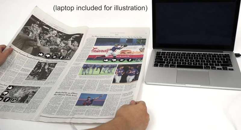 Eine interaktive Tageszeitung? Das wäre doch was. (Foto: Screenshot / Youtube)