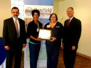 """The Clearfield Hospital was applauded for its """"A Culture of Always"""" Program and presented with a HAP 2013 Achievement Award on Wednesday. Shown, from left, are Gary Macioce, president of Clearfield Hospital; Dolores """"Dee"""" Hanna, R.N., education manager; Kathy Baumgratz, R.N., medical/surgical director; and Andy Carter, president and Chief Executive Officer of The Hospital and Healthsystem Association of Pennsylvania. (Photo by Jessica Shirey)"""