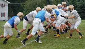 TIDE RUSH - Curwensville's football squad works on blocking schemes for extra-points in the pre-season.  (photo by Rusty McCracken)