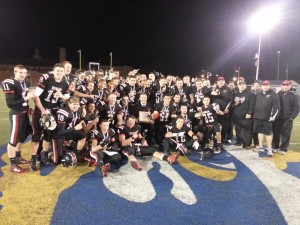 The Clearfield Bison squad for 2013 join their coaching staff to celebrate their District 5-6-8-9 championship.