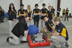 """During the 4-H DEADLOX FRC Team 4484 Social on Feb. 7, the team showcased its 2014 robot, """"The LOXsmith 2.""""  Pictured, kneeling from left to right, are State Rep. Matt Gabler, Padon Rishell, team vice-president, and Andrew Wells, team president.  Standing, in back from left to right, are Alaina Anand, team treasurer, Neel Rajan, safety captain, Alex Feldbauer, team secretary, Kameron Haines, Zach Jaggi and Amir Hassan, team ambassador.  Missing from photo is Brianna Kunes.  (Provided photo)"""