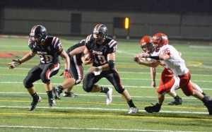 Erik Sellers led the Bison Friday night with four TDs (Photo by Logan Cramer III)