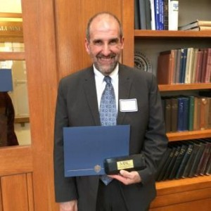 Robert Loeb is shown with his 2015 John Romano Faculty/Staff Diversity Recognition Award. (Provided photo)