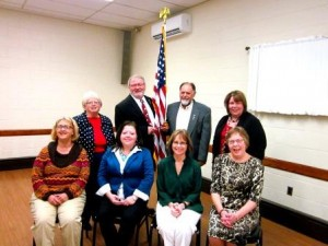 Pictured in the front, from left, are Susan Pyke, incoming vice president and Lions Club president; Holly Komonczi, VCC; Kathy Gillespie, Rotary Club president; and Susan Wingard, incoming secretary and GFWC president.  In the back row are Janice Elensky, incoming treasurer; Bill Williams, incoming president; Duane Test, outgoing president; and Sheila Williams, BPW president. (Photo by Wendy Brion)