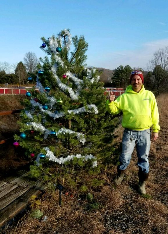 "Arnold Swales of Clearfield said it was wonderful to discover the tree trimmed in splendor again, and he wished a ""big Merry Christmas"" to Angie Peters, Kassi Dixon and their fellow elves for saving his little Christmas tree tradition. (Photo provided by Mike Norris)"