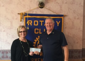 Pictured, from left, are: Kathy Gillespie, chief executive officer, CCAAA Inc., and Jack West, club president. (Provided photo)