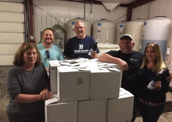 Making wine in support of Penn State DuBois athletics are, left to right: Terri Mathews, Jeff Gasbarre, Mike Nesbit, Chip Mathews and Jen Young. (Provided photo)