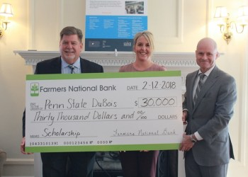 Penn State DuBois Chancellor M. Scott McBride, left, accepts a $30,000 check for the establishment of an Open Doors Scholarship from Farmers National Bank Vice President and Director of Retail Banking Danyell Bundy and President and Chief Executive Officer William C. Marsh.  (Provided photo)