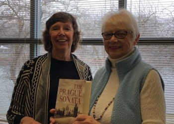 Gwen Crandell (on left) introduces Pat Bishop, who reviewed the book Prague Sonata by Bradford Morrow at this week's Books Sandwiched-In program at Shaw Public Library. (Provided photo)