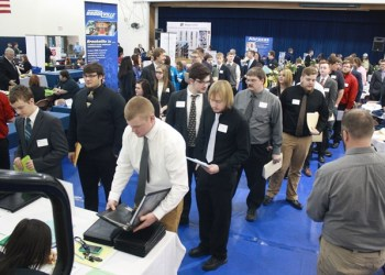 Jobseekers interact with employers during last year's career fair in the campus gymnasium.   (Provided photo)