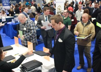 Student Dan Hinton, in front, prepares to meet with potential employers as he registers for the Penn State DuBois Career Fair. (Provided photo)