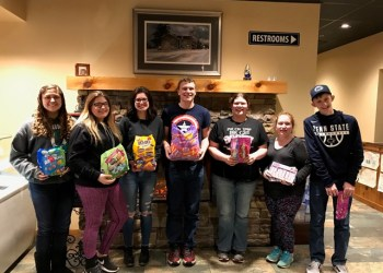 At their recent meeting March 7, the Clearfield County 4-H Teen Council members donated a variety of candy for their upcoming Easter Egg-Stravaganza. From left to right are Genesis Kacsmar, Chloe Pflueger, Lindsey Swisher, Ryan Lazauskas, Vesta Brickley, Shelby Flanagan and Aaron McCloskey.  (Provided photo)