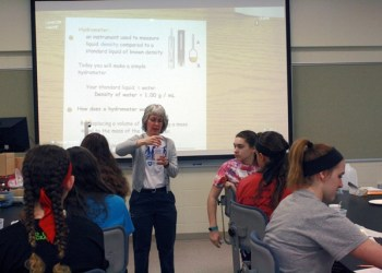 Presenter Sue Swope, an adjunct instructor in chemistry at Penn State DuBois, instructed girls in making a simple hydrometer during her workshop. Hydrometers are used in work with chemistry and other applications to measure the density of liquids.  (Provided photo)