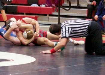 Freshman Luke McGonigal nearly pinned his opponent on Tuesday night. (Photo by HL)