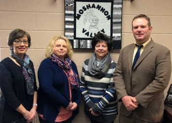 The Major Christopher E. Reed Memorial Scholarship endowment was presented by friend/classmate, Gina Mital, (left-middle) and his wife, Liz Reed, (right-middle) to MVCEF members Elsie Harchak (left) and Kris Albright (right).   (Provided photo)