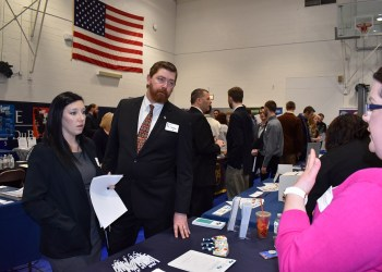 Students Laura Ruane and Ken Larsen, at left, learn about career opportunities in the mental health field by speaking to Stephani Seidle, a representative from Roads to Recovery of Clearfield and Clarion. (Provided photo)