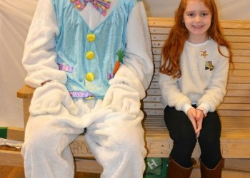 Elsey Turner of West Decatur was all smiles to meet and pose with the Easter Bunny during last year's Indoor Easter Egg-Stravaganza. In 2018, the event welcomed more than 220 children in Clearfield and surrounding areas. (Provided photo)