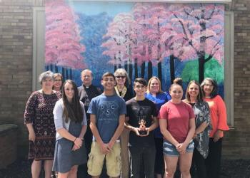 Pictured, in the first row, are: Carleigh Kuntz, art teacher; Herschel Johnson; Kyler Rosinsky; Haley Owens; and Leann Adams, art teacher. In the second row are: Loretta Wagner, CRC Main Street manager; Arianne Greslick and the Rev. Robert Way, CRC board members; Gloria Rowles, SRACC treasurer; Maria Lemmo, CRC board member; and Lisa Kovalick, CRC board president. (Provided photo)