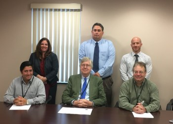Pictured, in front, are: Commissioners Tony Scotto, John A. Sobel and Mark B. McCracken. In the back are: Chrissy Davis, Dennis Arnold and Zach Murone of the county's Probation Department. (Photo by GANT News Editor Jessica Shirey)