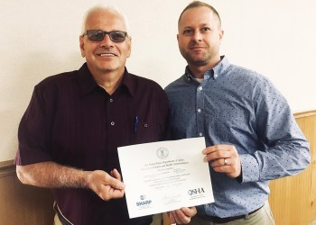 Dave M. Yanoschick Jr., CSP, IUP OSHA Consultation, right, presents the SHARP Certificate to Terry Fustine, safety coordinator, Phoenix Sintered Metals LLC in Brockway. (Provided photo)