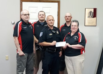 Pictured, in the front, are Police Chief Vincent McGinnis and Clearfield Fire Department President Deb Gray. In the back are Treasurer Gary Shugarts, Assistant Fire Chief Andrew Smith, and Member Randy Peacock. (Photo by Wendy Brion)