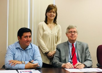 Pictured, in back, is Mary Brown, BH program specialist with Community Connections, with Commissioners Tony Scotto and John A. Sobel (front). (Photo by GANT News Editor Jessica Shirey)