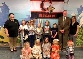 In the first row are:  Zoey Rosenbaum, Libby Albright, Ally Gibson, Reese Sankey and Toree Sankey. In the second row are: Bobbie Johnson (CCAAA), Kailynn Sankey, Emma Jacob, Bailee Jacob, Caleb Gibson, Collin Forcey, Mr. Ken Veihdeffer (CAE principal) and Stefanie Sattesahn (CAES school nurse). (Provided photo)
