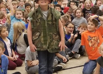 Collin Nevling, a third-grade student, is shown sporting military wear. (Provided photo)