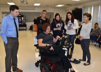 Melissa Davis from Laurel Medical Solutions demonstrates the use of a wheelchair equipped with Eye Gaze technology at the Penn State DuBois Assistive Technology Fair. The system allows the user to control movement of the wheelchair using only their eyes. (Provided photo)