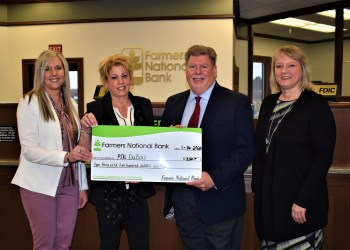 Pictured, from left, are: Farmers National Bank Vice President of Business Banking Danyell Bundy and DuBois Branch Manager Kelli Allison, who present a $2,500 check to Penn State DuBois Chancellor M. Scott McBride and Director of Development Jean Wolf. (Provided photo)
