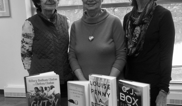 Janet Coons, Pat Bishop and Gwen Crandell offer a glimpse of books they will be reviewing for the Books-Sandwiched-In series at Shaw Public Library on March 18, 25, and April 8.  Missing from photo:  Judy Davis. (Provided photo)