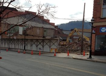 A patch of sky and a view of the mountains peaks through a gap in the buildings of Market Street in downtown Clearfield. Demolition is well underway to make room for the CNB expansion project. According to previous GANT News articles, the first phase of the project starts with the demolition of the buildings, which is expected to be complete within the next few weeks. Plans are well under way for a 17,000-square foot building expansion. The new construction will begin in the late spring of 2020, with anticipated completion of the project in the second quarter of 2021. Expansion plans are also designed to maintain the historical downtown façade to match Clearfield's existing architecture. Two businesses previously located in the buildings have relocated. The Chamber of Commerce has moved to 218 S. Second St., and Lefort's Sweet Shoppe to 22 N. Third St.; the location also previously housed Happy Events Photography.