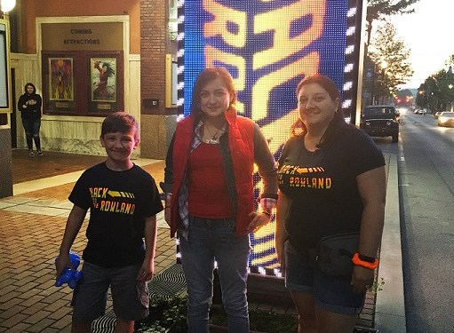 The Rowland Theatre in Philipsburg had many clever ideas to support their showings of older films during the pandemic. They opened in June 2020 with Back to the Rowland as their theme as they presented the classic Back to the Future. Getting into the spirit of the film, Kelley Wilks of Philipsburg, center, dressed as Marty McFly and Johnny Levonick, at left, and his mother Ambra Levonick, at right, wore Back to the Rowland t-shirts.  (Photo courtesy of the Rowland Theatre)