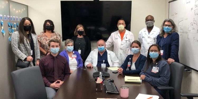 Standing from left to right are Olivia Marchioni, rural health outreach coordinator, CJDAC; Carol Jackson, case management director, CJDAC; Susan Ford, executive director, CJDAC; William Hoff, MD, trauma medical director, PHD; Nii-Daako Darko, DO, trauma surgeon, PHD; Vicki Feldman, BSN, RN, PHRN, EMS outreach and injury prevention coordinator, PHD.  Seated from left to right are Curtis Daub, Case Manager, CJDAC; Tracey Brumberg, RN, data registry specialist; Robert Dice, MS, RN, Trauma program manager, PHD; Holly Hertlein, RN, CEN, trauma performance improvement coordinator, PHD; Katie Shields, MSN, RN, clinical nurse educator, PHD.
