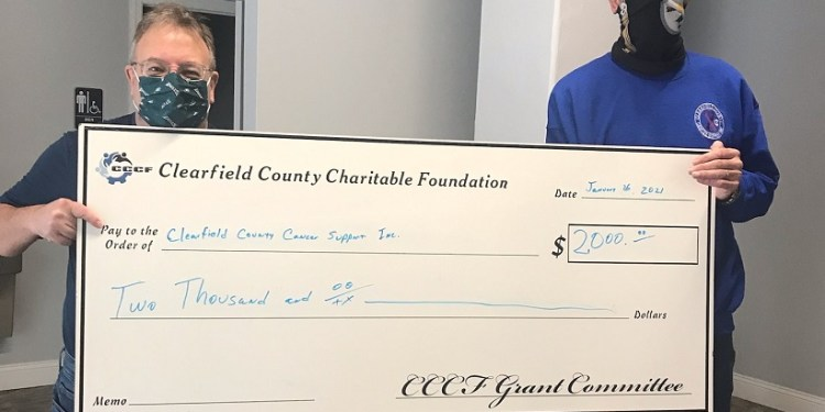"""In January, Charitable Foundation Executive Director Mark McCracken presented Mike Greene, president/chief executive officer of Clearfield County Cancer Support Inc. a grant for $2,000.    The funding was used by Cancer Support to help people undergoing cancer treatments meet their monthly financial obligations.    Greene said: """"the funding received from CCCF allows us to help cancer patients so they can concentrate on getting better and won't have to worry about daily household expenses."""" (Provided photo)"""