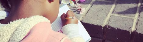 Photo of little girl drawing some flowers