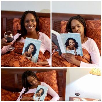 Image of Women reading Becoming in bed while having a glass of wine.